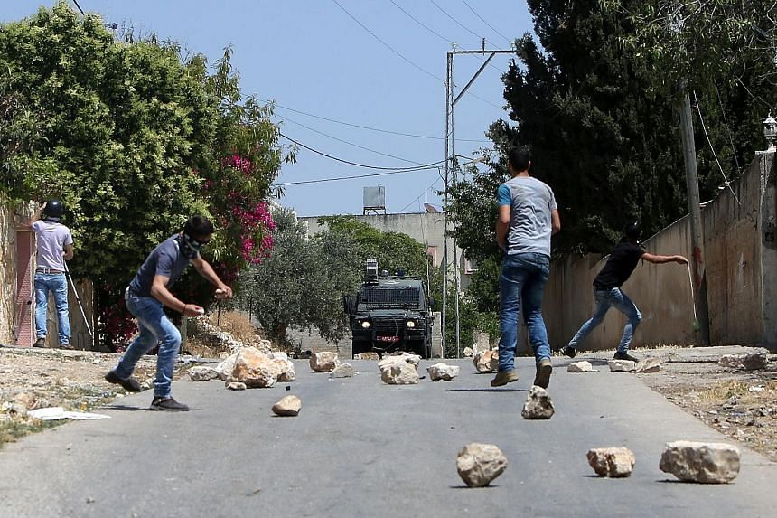 Palestinian protesters hurling stones at Israeli security forces during clashes. Although Palestine is willing to have a peacekeeping force - from Nato states that are friendly to Israel - to replace Israeli troops in the West Bank, Israel is opposed