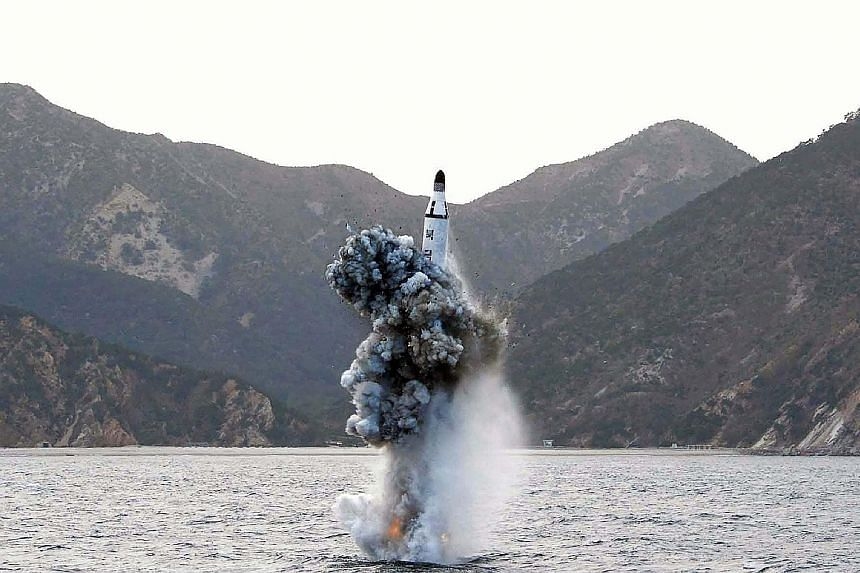 An April 24 photo from North Korea's official news agency shows the underwater test-firing of a strategic submarine-launched ballistic missile. This week, Pyongyang released a video of the test - shortly before the North Korean envoy was to meet Chin