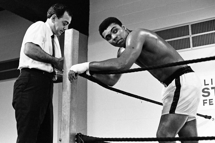 Muhammad Ali (right) with his trainer Angelo Dundee ahead of his fight with Ernie Terrell at the Astrodome, Houston, on Feb 6, 1967.