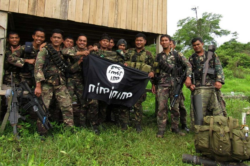 Philippine soldiers displaying the Islamic State flag after overrunning a militant camp in Butig town in the southern Philippine island of Mindanao.