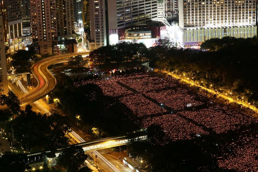 Thousands of people take park in a candlelight vigil to mark the 27th anniversary of the crackdown.