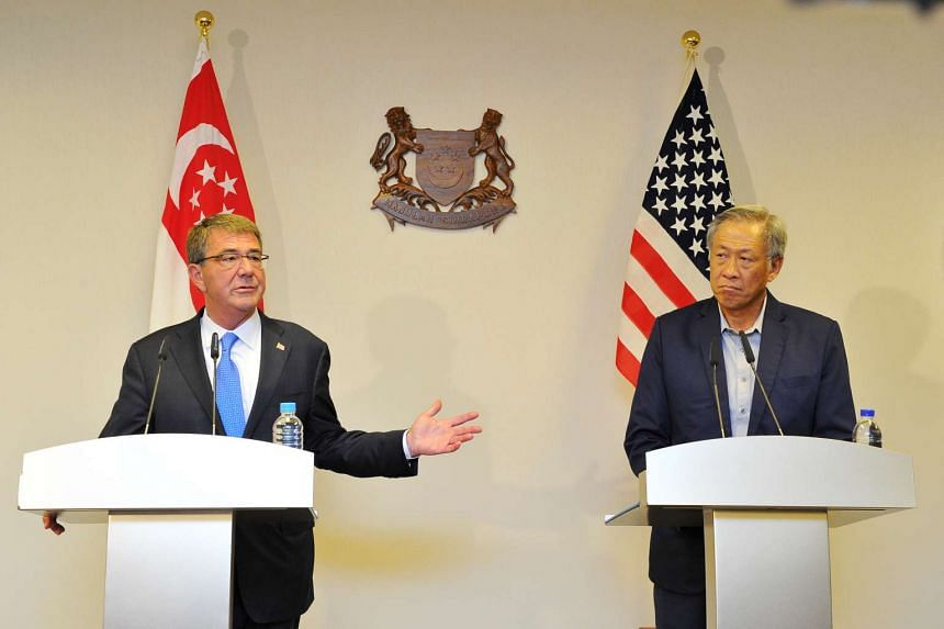 Defence Minister Ng Eng Hen (right) and his US counterpart Ashton Carter speaking at the Paya Lebar Airbase on June 2.