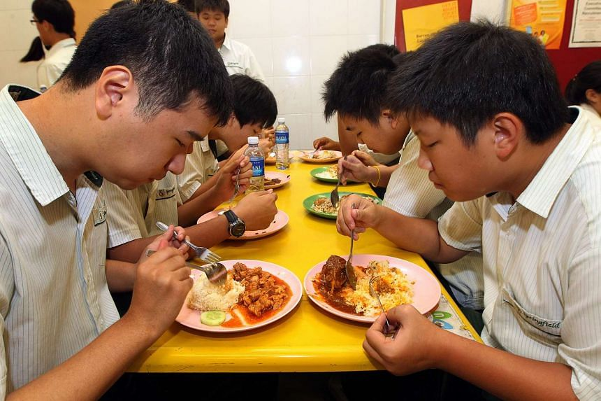 A group of boys from Springfield Secondary School having a meal in their school canteen, on March 24, 2011.