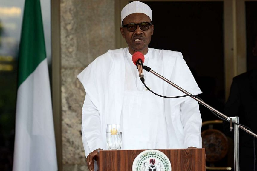 Nigerian President Muhammadu Buhari speaking at a press conference at the Presidential Palace in Abuja, on May 14, 2016.