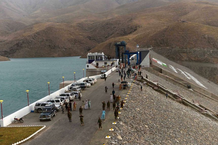 Afghan National Army (ANA) soldiers and labourers walk over the Salma Hydroelectric Dam at Chishti Sharif in eastern Herat, on June 2, 2016.