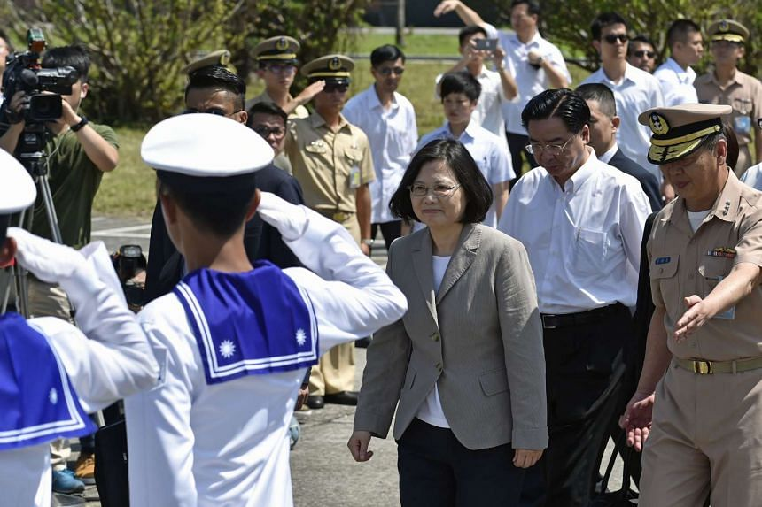 Taiwan's President Tsai Ing-wen (centre) arrives at the Su'ao naval base in eastern Yilan County, on June 4, 2016.