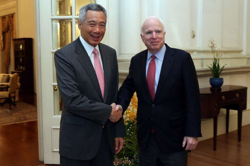 Prime Minister Lee Hsien Loong shakes hands with Chairman of the US Senate Armed Services Committee Senator John McCain, on June 4, 2016.