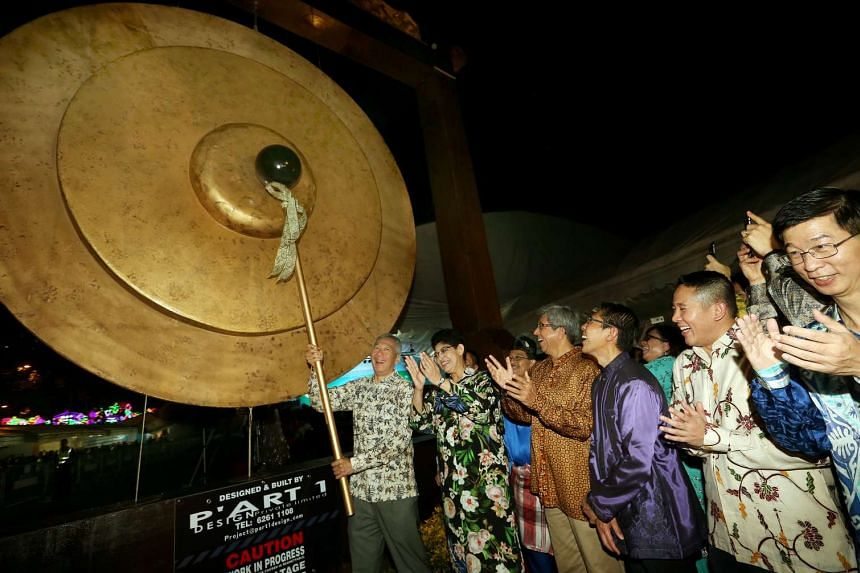 PM Lee Hsien Loong strikes a gong at the open space at the former Malay Village site on June 4, 2016.