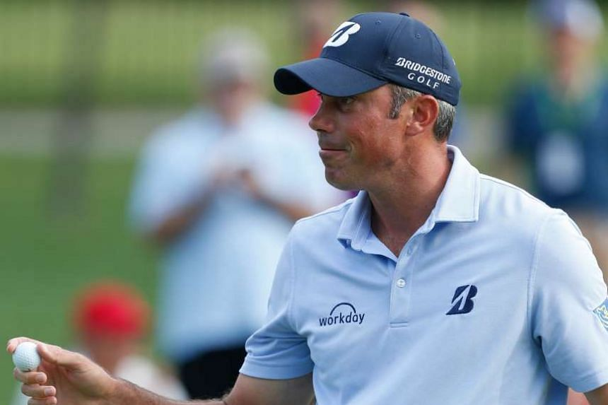 Matt Kuchar waves to the gallery after making a par on the 10th hole during the second round.