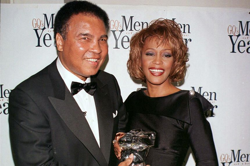 Singer Whitney Houston (right) presenting Ali with GQ's Courage Award at Radio City Music Hall in New York in 1998.