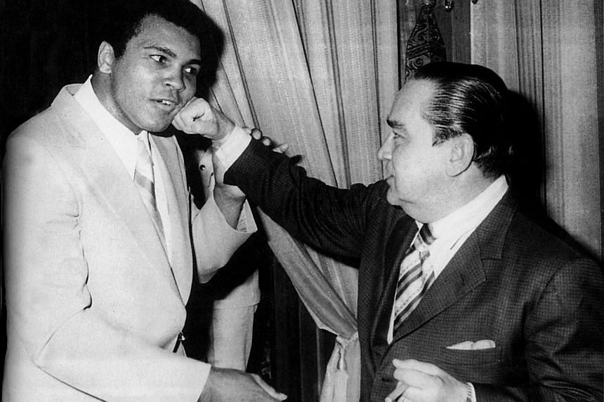 """Sabah's then-chief minister Tun Fuad Stephens (right) """"sparring"""" with Ali on his visit to the Malaysian state in 1974."""
