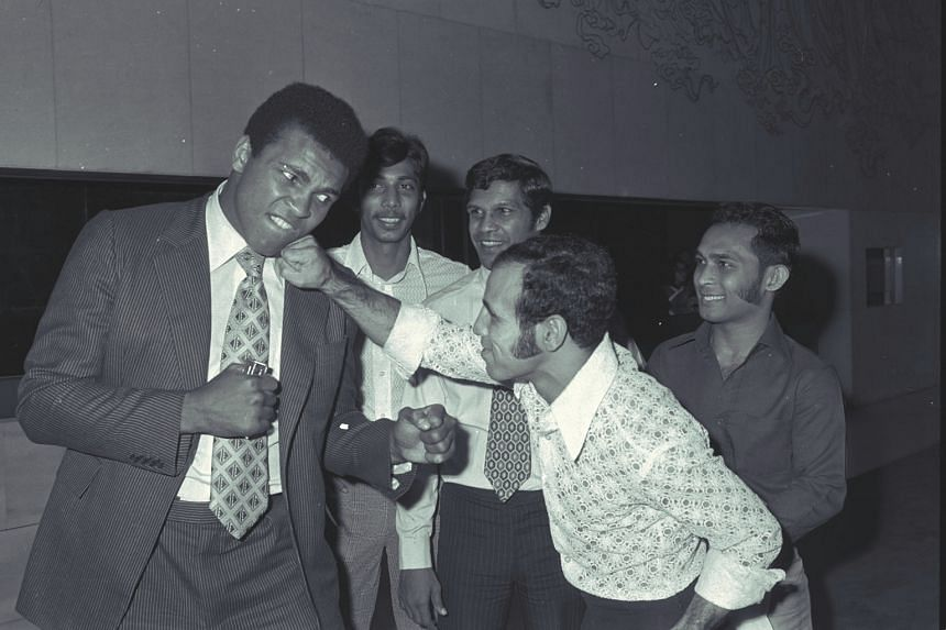 Muhammad Ali (left) at the Mandarin Hotel in Singapore on Oct 22, 1973. Ali was in town take part in two exhibition fights.