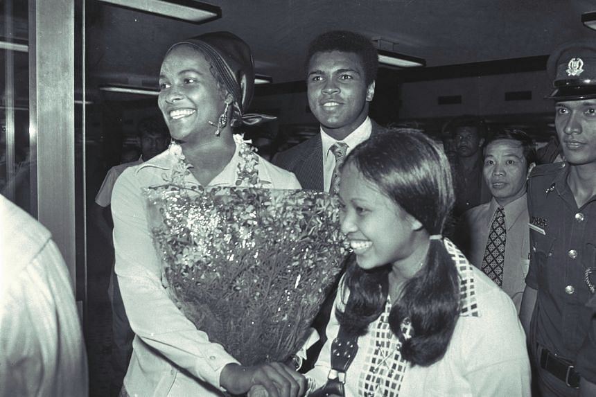 Muhammad Ali arriving at the Paya Lebar Airport with his wife Belinda, mother, and members of his tour group on Oct 22, 1973.
