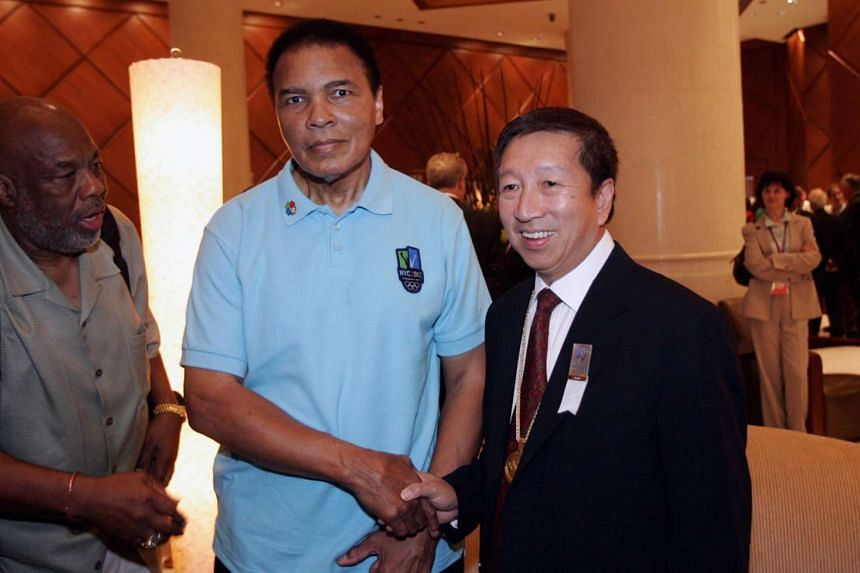 Muhammad Ali meeting Mr Ng Ser Miang, Vice-President of the Singapore National Olympic Council, at Raffles The Plaza on July 5, 2005.