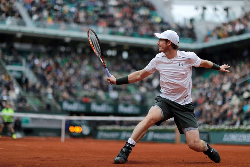 Murray returns the ball to Wawrinka during their men's semi-final matc.