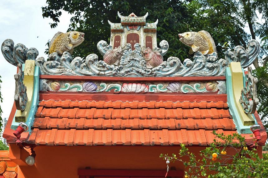 Colourful sculptures dot the roof (above) of the temple.