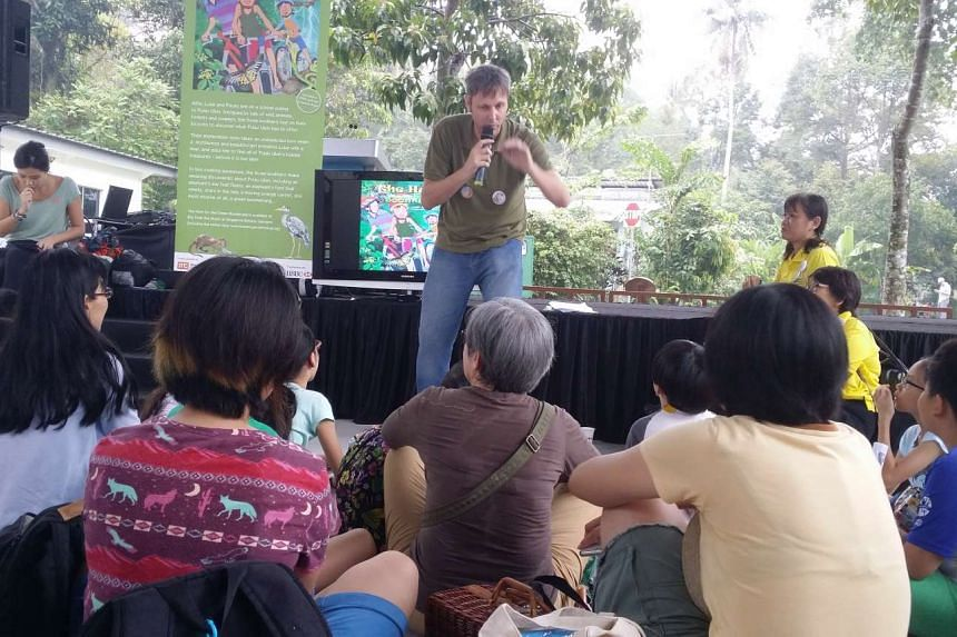 Author Neil Humphreys (centre) telling children about his new book, The Hunt for the Green Boomerang.