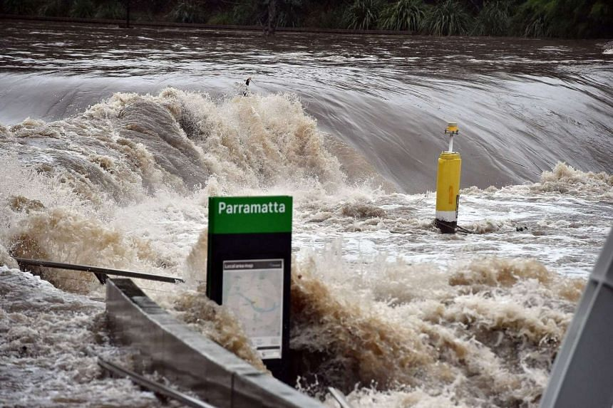 A ferry terminal is submerged by the overflowing Parramatta river in Sydney on June 5, 2016.