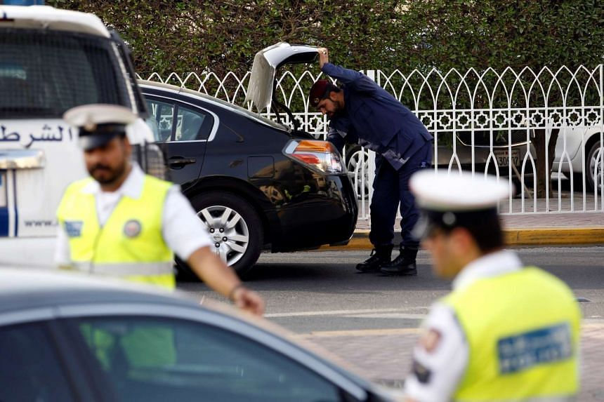 Police inspect cars at a checkpoint, during a manhunt for prisoners that escaped from Muharraq jail, in Manama, Bahrain on June 4, 2016.