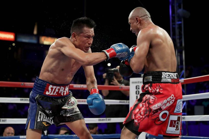 Orlando Salido (right) throws a right at Francisco Vargas during their WBC super featherweight championship bout at StubHub Center on June 4, 2016 in Carson, California.