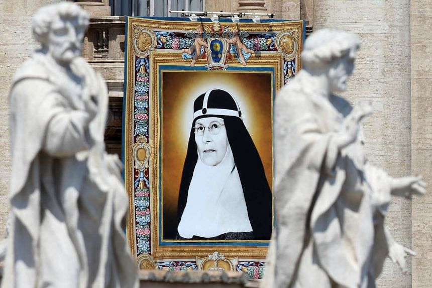 A tapestry showing Swedish nun Sister Mary Elizabeth Hesselblad hangs from a balcony in St Peter's Square during her canonisation ceremony, on June 5, 2016.