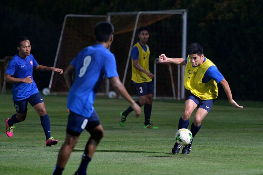 Singapore Under-21 midfielder Hazim Faiz Hassan (with the ball) in traning with the Garena Young Lions on May 24, 2016.