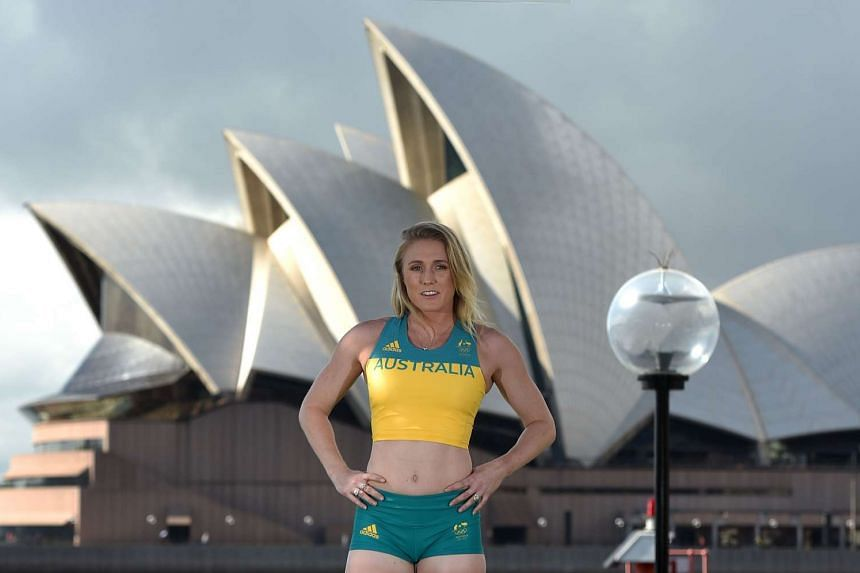 Australian Olympic defending hurdles champion Sally Pearson poses for photos by Sydney Harbour at a media launch to unveil the official uniforms to be worn by the Australian Olympic team during the 2016 Games, on April 19, 2016.