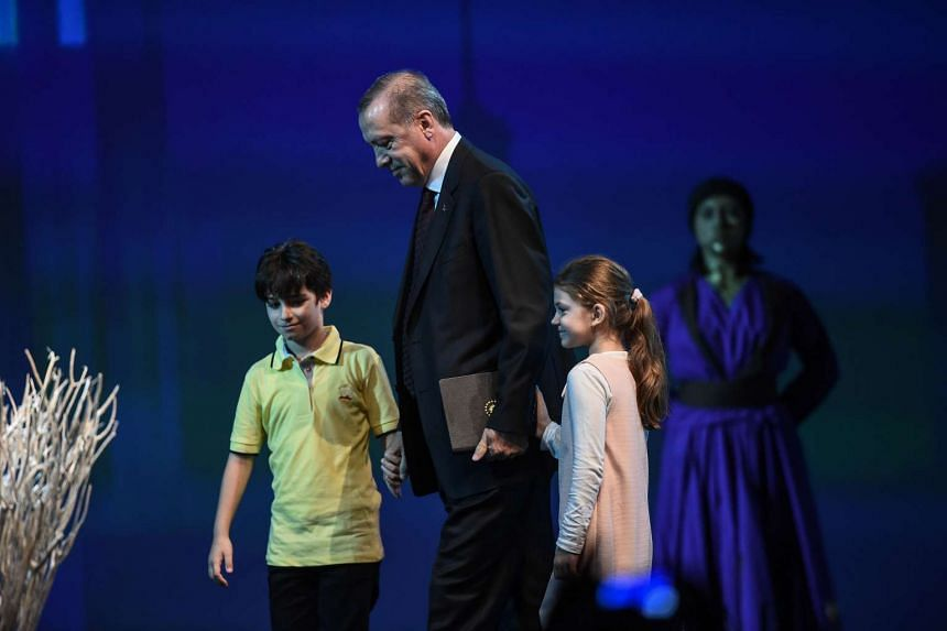 Children lead Turkish President Recep Tayyip Erdogan on May 23, 2016 during the World Humanitarian Summit opening cerenomy in Istanbul.
