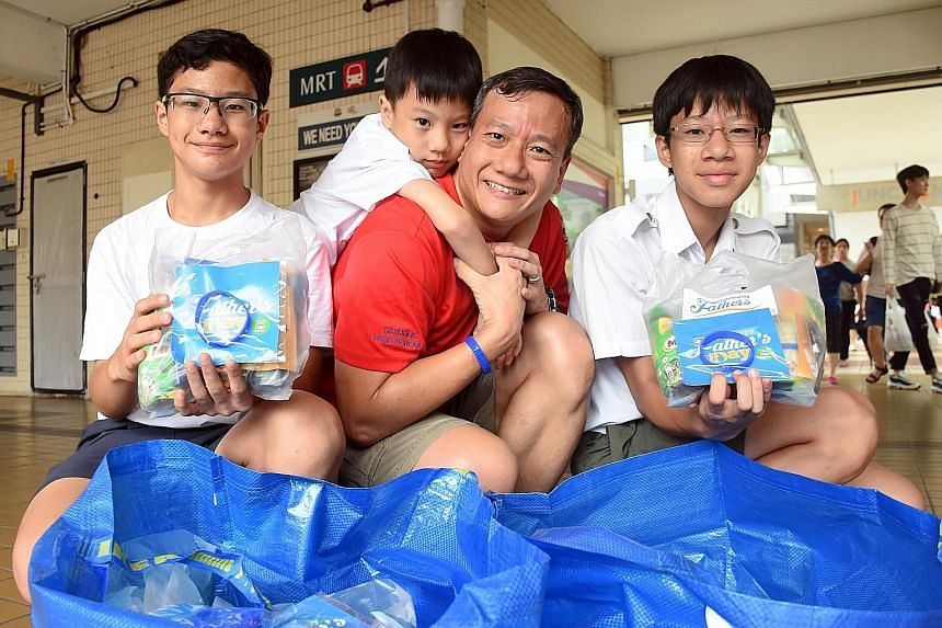 Dads found wearing the Celebrating Fathers movement's wristband got goodie bags yesterday. One such dad was Mr Adrian Gerard Seah, seen here with his sons (from left) Alexander, Alpherius and Angelo.