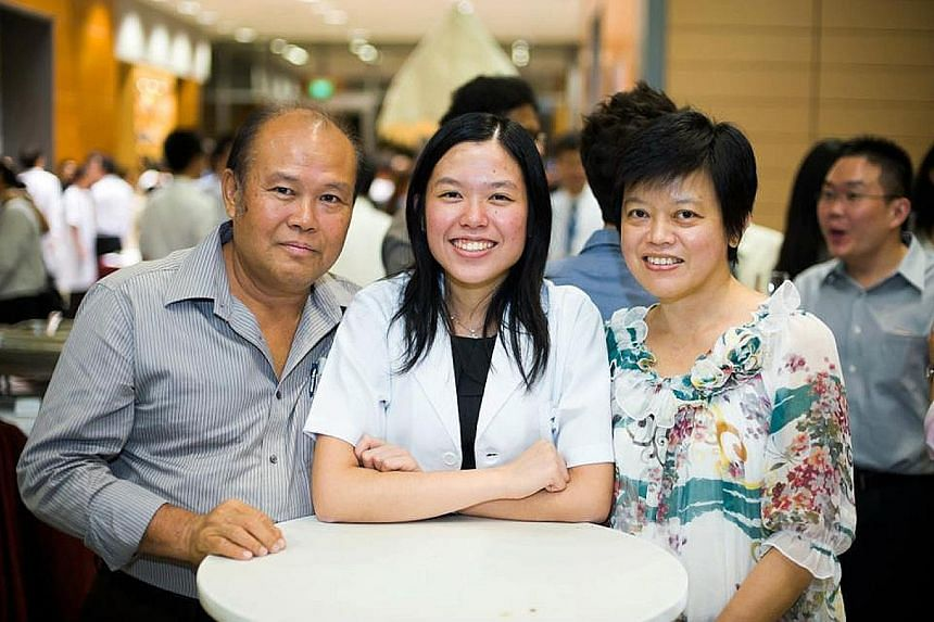 (Top) Part of a letter Ms Noviani's late mother had written to her. (Above) Ms Noviani with her parents in 2011.