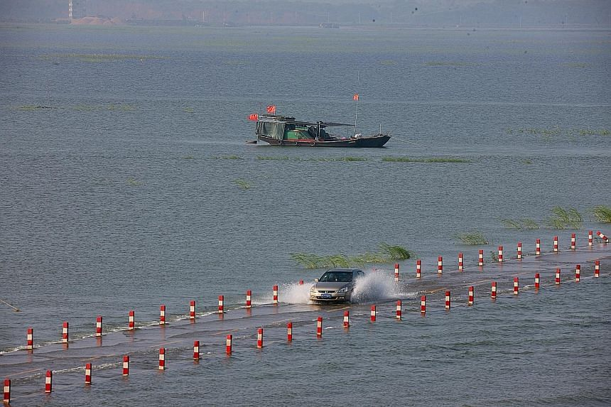 "The ""most beautiful water highway"" across Poyang Lake, China's largest freshwater lake, in Jiangxi province lies flooded following continuous rain. Hundreds of thousands of people across China have been affected by heavy rains and flooding, and more"