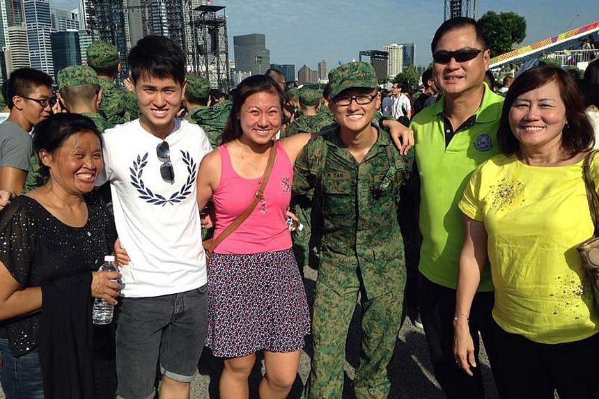 (From left): Ms Mintarsih with the Tan siblings Ivian, 22; Ivyna, 23; Isaac, 20; and their parents Ivan, 60; and Ivy, 56; at Isaac's passing-out parade in July 2014.