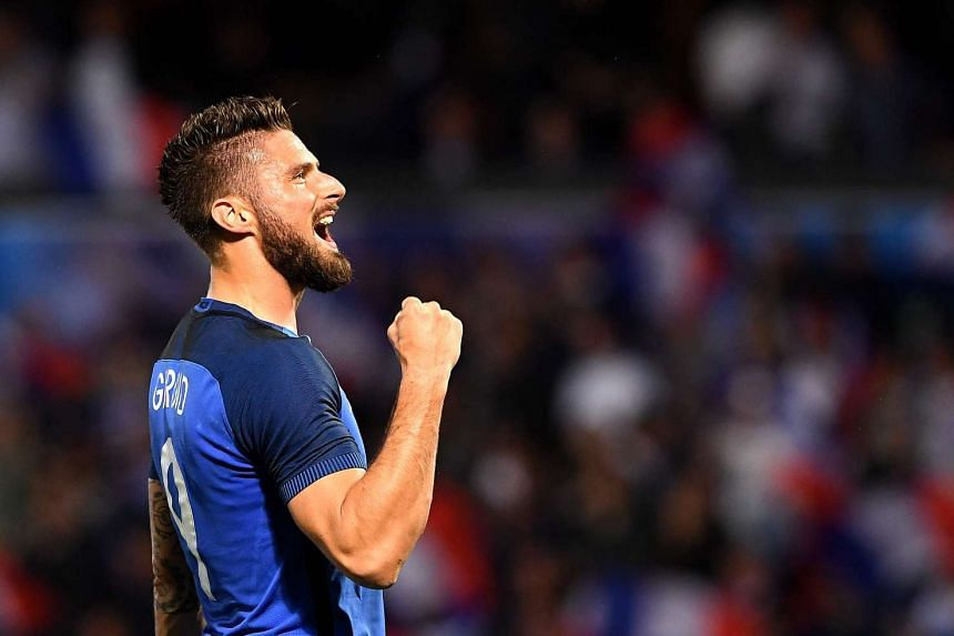 Giroud celebrates his goal during the friendly football match between France and Scotland.