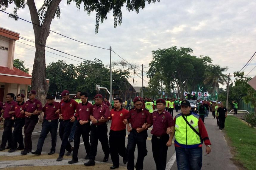 Supporters of Malaysia's opposition Parti Islam SeMalaysia marching to the by-election nomination centre in Sungai Besar, Selangor state, on June 5.