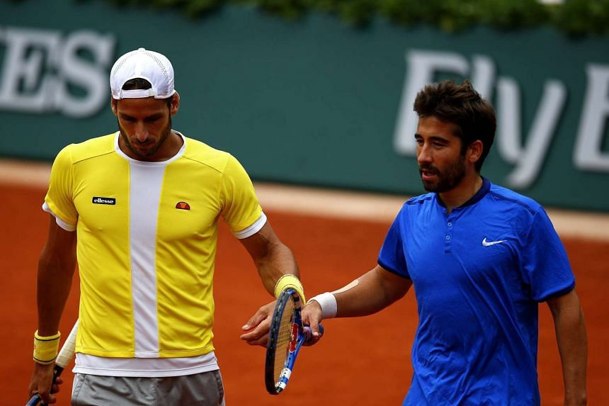 Feliciano Lopez (left) and Marc Lopez of Spain in action against Mike Bryan and Bob Bryan of the US.