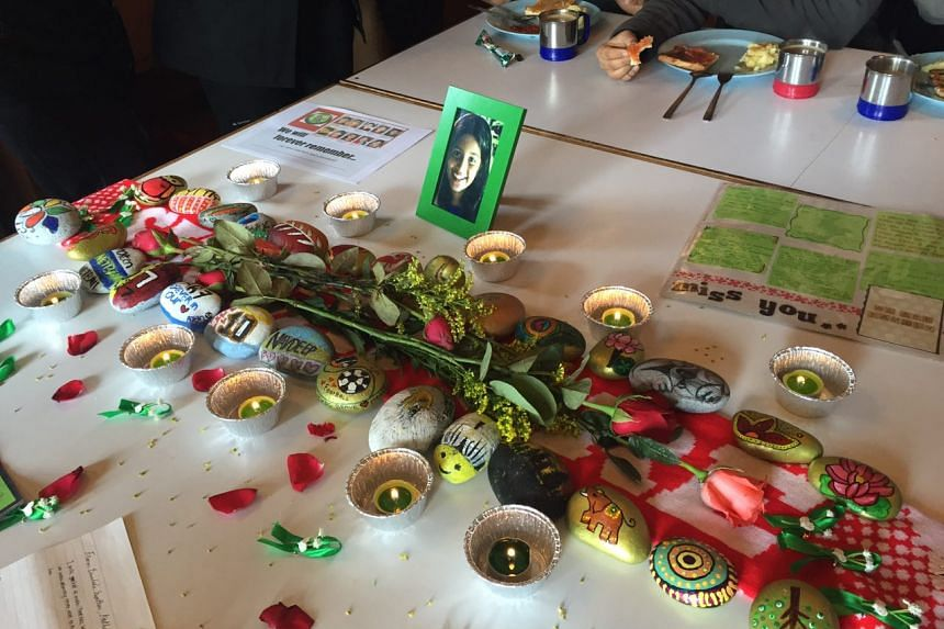 Candles and pebbles laid out on the tribute table in Kota Kinabalu where parents, ex-schoolmates, relatives and former teachers of TKPS have gathered on June 5.