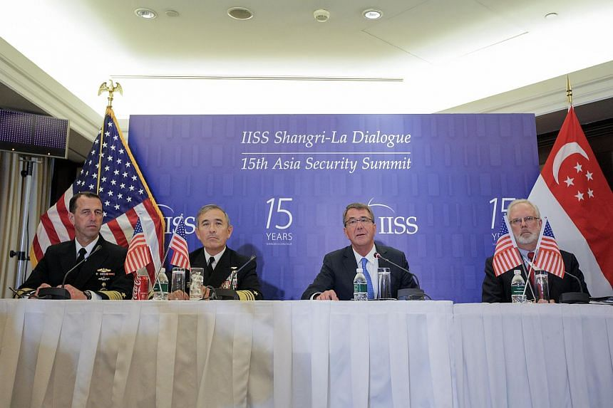 US secretary of defence Ashton Carter (second, right), US Navy chief of naval operations Admiral John Richardson (left), and US Navy head of pacific command Harry B. Harris (second, left) at the IISS Shangri-La Dialogue Asia Security Summit on June 4