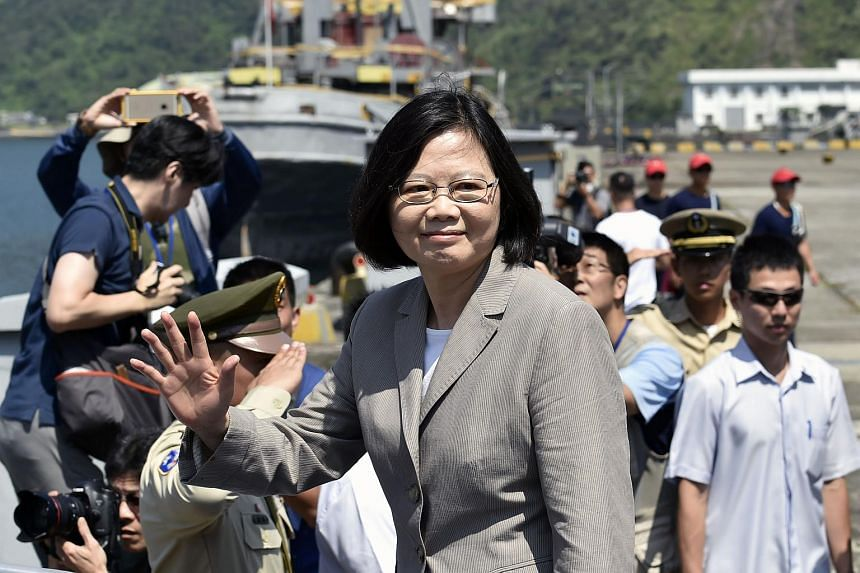 Taiwan President Tsai Ing-wen (center) waves to the press while inspecting the Suao naval base in eastern Ilan county on June 4.