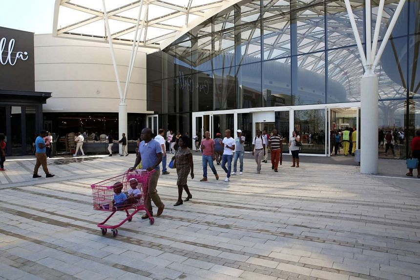 Shoppers walk during the opening of the Mall of Africa in Midrand outside Johannesburg, South Africa, on April 28, 2016.