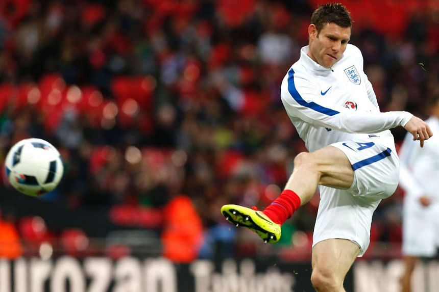 England's midfielder James Milner warms up before the friendly football match between England and Portugal at Wembley stadium in London on June 2, 2016.