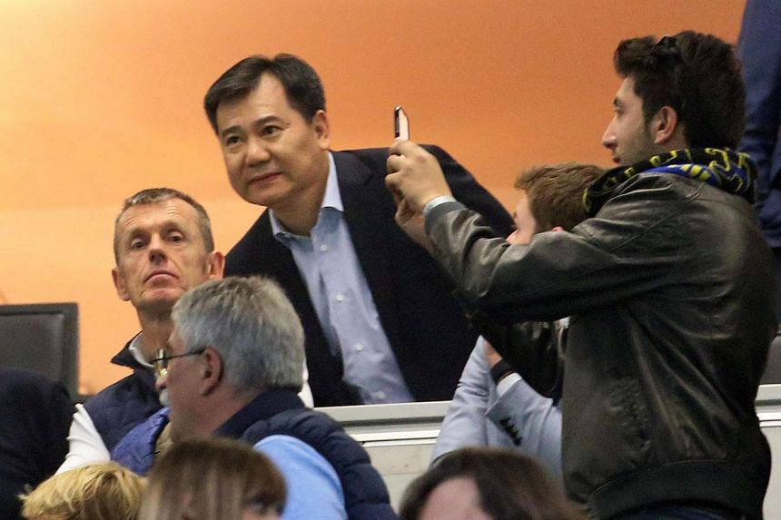 Jindong Zhang (centre), CEO of the Suning Commerce Group, arriving for the Italian Serie A football match between Inter Milan and Udinese Calcio, on April 23, 2016.