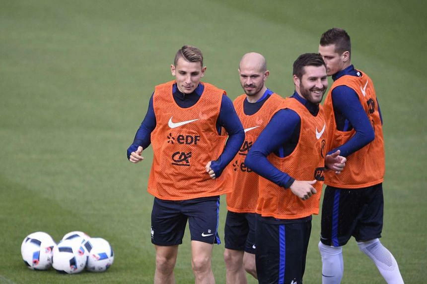 (From left) France's Lucas Digne, Christophe Jallet, André-Pierre Gignac and Morgan Schneiderlin attend a training session at the St Symphorien Stadium in Longeville-les-Metz on June 3, 2016.
