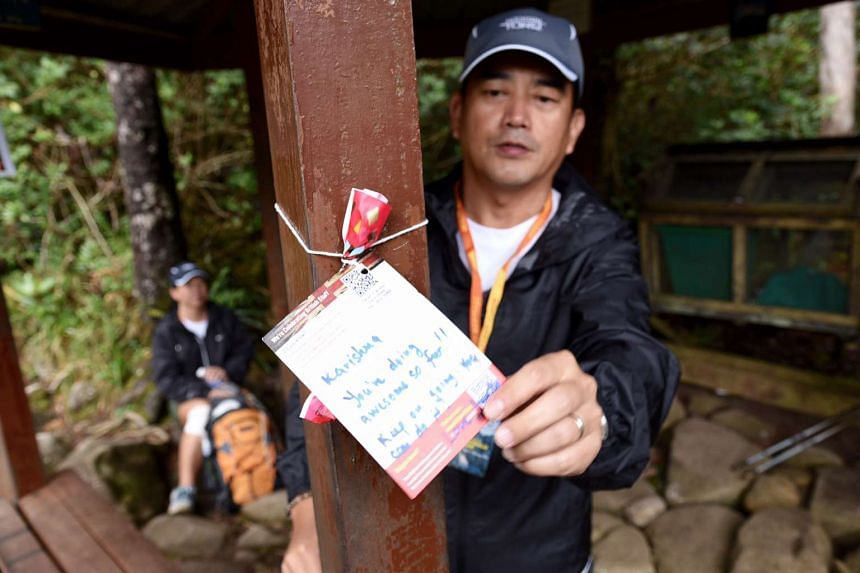 Husband and wife team, Tonny Phuay and Joyce Lim, makes their way up the gruelling trail to Laban Rata, which is the rest point before the climb to the summit of Mount Kinabalu. Their daughter Chantal, who was ahead of them ,was a survivor of last ye