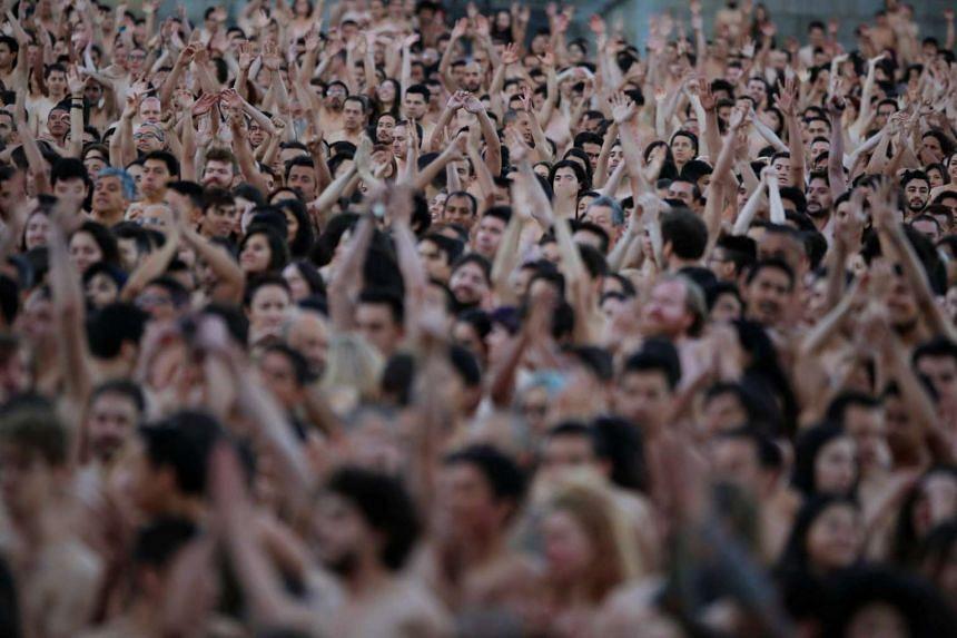 Naked volunteers pose for US artist Spencer Tunick at Bolivar Square in Bogota,Colombia, on June 5, 2016.