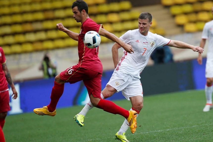 Russia's Igor Denisov (right) in action at the international friendly football match between Russia and Serbia on June 5, 2016.