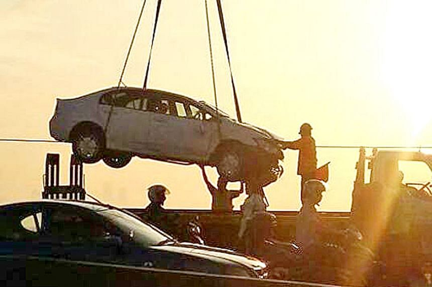 A Singapore-registered car crashed onto the railway tracks on the Causeway on Monday (June 6) .
