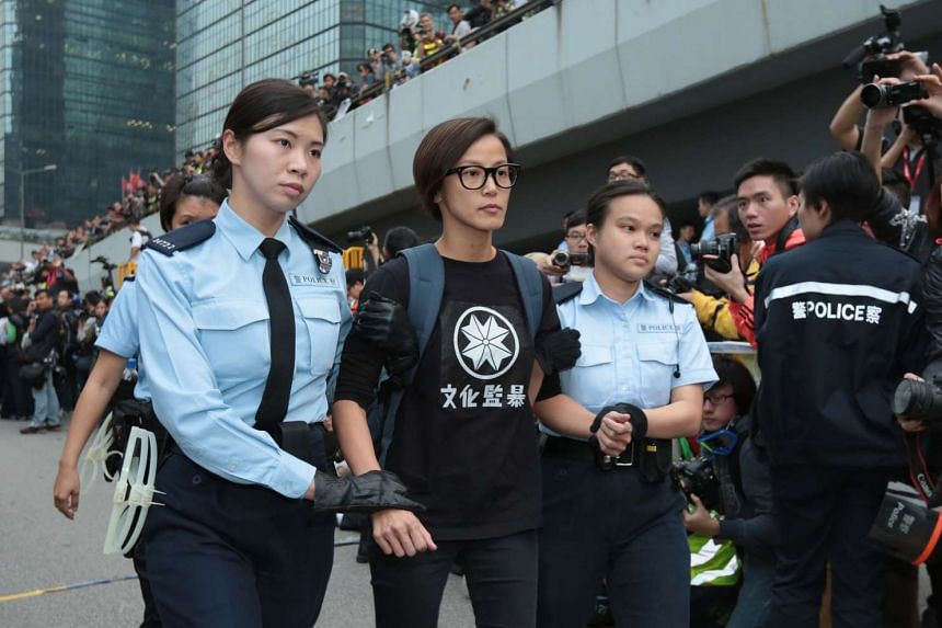 Police arrest Denise Ho (centre), after she refused to leave the junction of Tim Wa Avenue and Harcourt Road in December 2014.