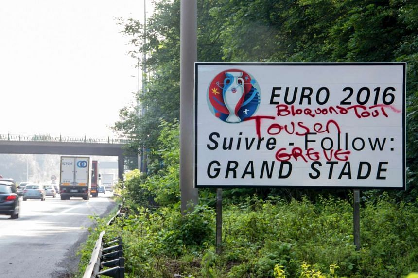 "Graffiti reading ""Let's block everything, all on strike"" is seen scribbled on a signboard for the Euro 2016 football competition, in Lille, France, on June 6, 2016."