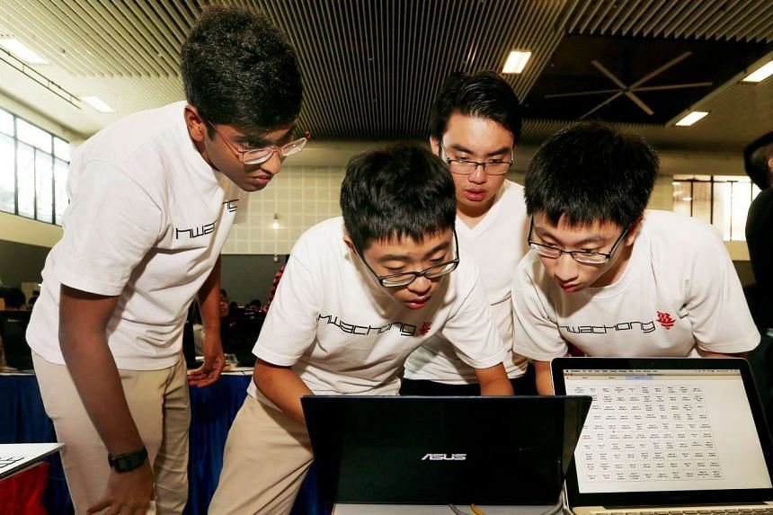 The team members of T0X1C V4P0R, a group from Hwa Chong Institution, working to complete a series of challenges in the competition at the Cyber Defenders Discovery Camp 2016.