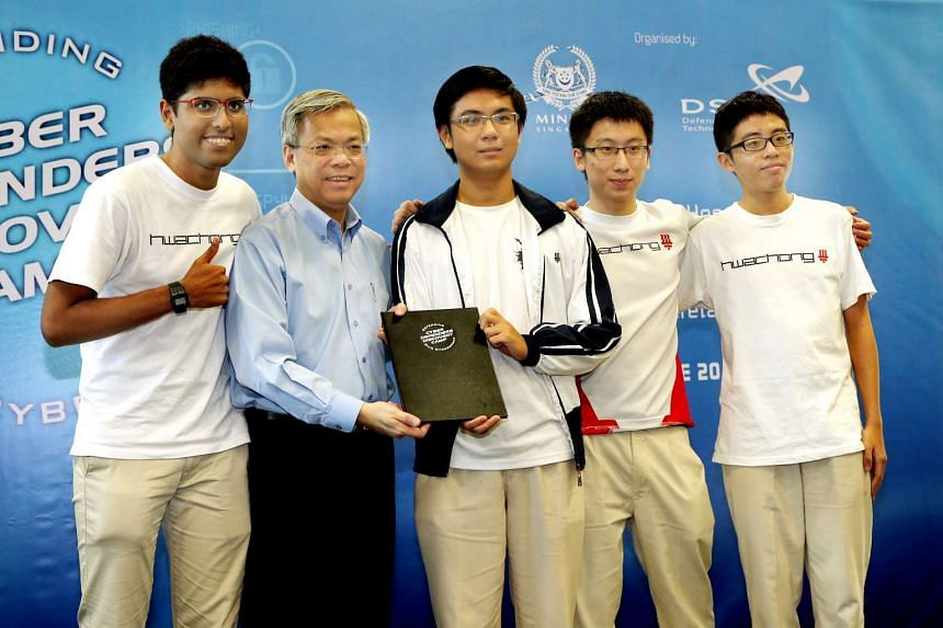 (From left) V. S. Ragul Balaji, Mr Chan Yeng Kit, Li Yicheng, Li Bailin and Ho Jie Feng on-stage at the award ceremony of the Cyber Defenders Discovery Camp 2016.